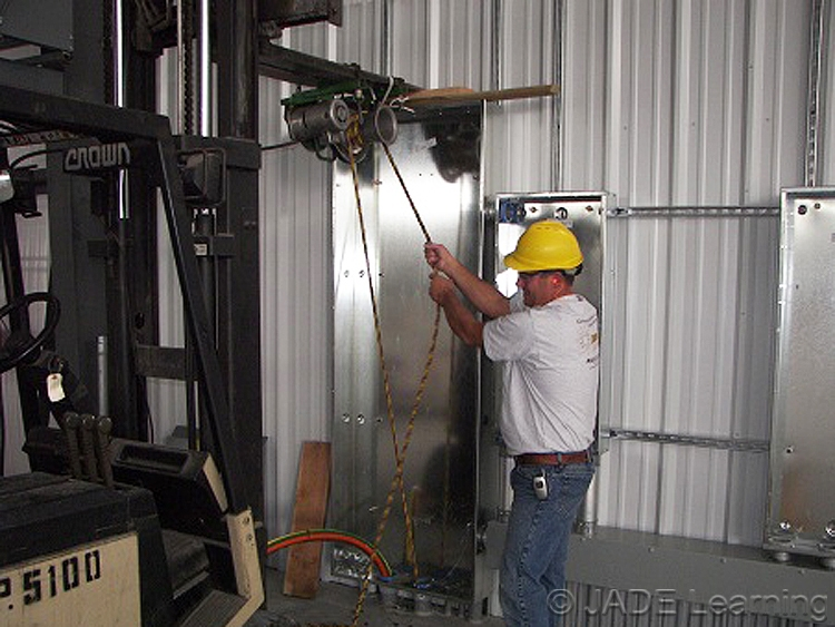 Industrial Electrician Pulling Wire